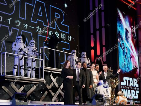 Stock Image of US film director Jeffrey Jacob Abrams (2-L), known as J. J. Abrams, promotes his film 'Star Wars: The Rise of Skywalker ', with US film producer Kathleen Kennedy (L), English actor John Boyega (3-L), English actress Daisy Ridley (4-L), US actor îscar Isaac (5-L), Anthony Daniels (6-L) playing C-3PO (3-R), R2-D2, BB-8 (2-R) and D-O (R) at a fun event in Tokyo, Japan, 11 December 2019. The film will be newly released in Japan on 20 December 2019.