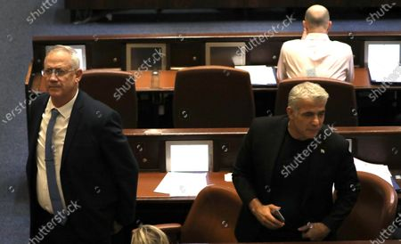 Leader of the Blue and White Party Benny Gantz (L) and Yair Lapid during a vote on a bill to dissolve the Israeli Parliament at the Knesset plenum (parliament) in Jerusalem, Israel, 11 December 2019. Media reports state that the Israeli government vote on a bill to dissolve the Israeli Parliament and will go to a third elections presumably on 02 March 2020 after negotiations talks between the Likud Party and the Blue and White Party failed.