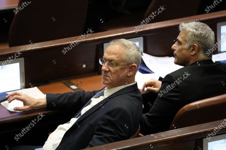 Leaders of the Blue and White Party Benny Gantz (L) and Yair Lapid (R) during a vote on a bill to dissolve the Israeli Parliament at the Knesset plenum (parliament) in Jerusalem, Israel, 11 December 2019. Media reports state that the Israeli government vote on a bill to dissolve the Israeli Parliament and will go to a third elections presumably on 02 March 2020 after negotiations talks between the Likud Party and the Blue and White Party failed.