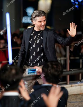 Oscar Isaac waves to fans as he arrives at an event promoting Star Wars: The Rise of Skywalker' in Tokyo, Japan, 11 December 2019. The film will be released in Japan on 20 December 2019.