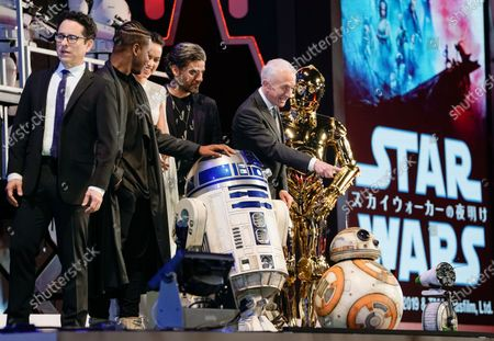 J.J. Abrams (L), British actor John Boyega (2-L), British actress Daisy Ridley (3-L), US actor Oscar Isaac (4-L) and British actor Anthony Daniels (5-L) attend an event promoting Star Wars: The Rise of Skywalker in Tokyo, Japan, 11 December 2019. The film will be released in Japan on 20 December 2019.