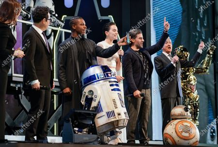 Kathleen Kennedy (L), US film director J.J. Abrams (2-L), British actor John Boyega (3-L), British actress Daisy Ridley (4-L), US actor Oscar Isaac (5-L) and British actor Anthony Daniels (6-L) attend an event promoting Star Wars: The Rise of Skywalker in Tokyo, Japan, 11 December 2019. The film will be released in Japan on 20 December 2019.