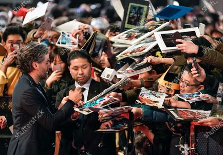 Oscar Isaac signs autographs at an event promoting Star Wars: The Rise of Skywalker' in Tokyo, Japan, 11 December 2019. The film will be released in Japan on 20 December 2019.
