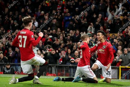 Mason Greenwood of Manchester United celebrates scoring his sides second goal  with Brandon Williams  and James Garner to make the score 2-0
