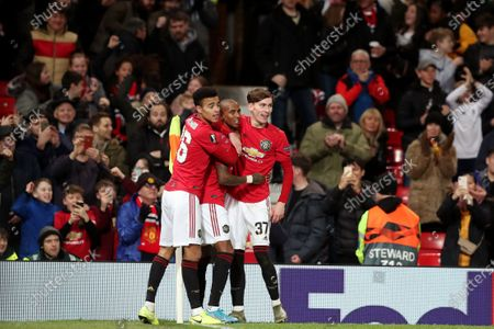 Ashley Young of Manchester United celebrates scoring his sides first goal with Mason Greenwood and James Garner to make the score 1-0