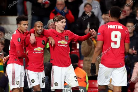Stock Image of Ashley Young of Manchester United celebrates scoring his sides first goal with Mason Greenwood and James Garner to make the score 1-0