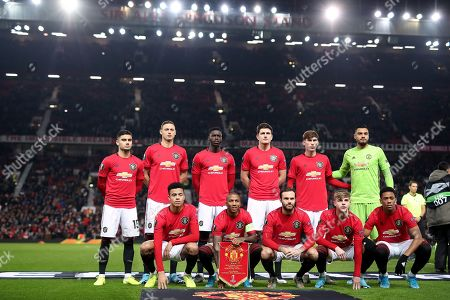 Manchester United players pose for a group photograph before kick-off. Back row L-R: Andreas Pereira, Nemanja Matic, Axel Tuanzebe, Harry Maguire, James Garner and goalkeeper Sergio Romero. Front row L-R: Mason Greenwood, Ashley Young, Juan Mata, Brandon Williams, Anthony Martial.