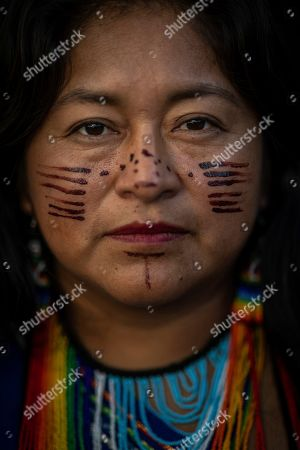 A member of the indigenous people of Ecuador attends a protest at the COP25 summit in Madrid,. World leaders agreed in Paris four years ago to keep global warming below 2 degrees Celsius (3.6 degrees Fahrenheit), ideally no more than 1.5 C (2.7 F) by the end of the century. Scientists say countries will miss both of those goals by a wide margin unless drastic steps are taken to begin cutting greenhouse gas emissions next year. Claiming that the message doesn't seem to be getting through to governments, over one hundred activists led by representatives of indigenous peoples from Latin and North America made their way to the talks' venue, blocking for some tense minutes the entrance to a plenary meeting where U.N. Secretary General Antonio Guterres was about to speak