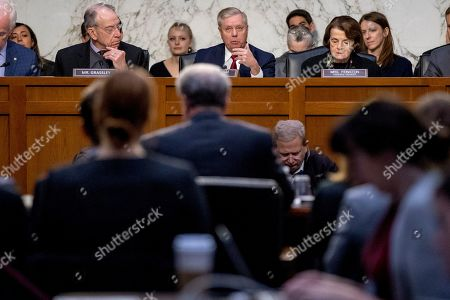 Michael Horowitz, Chuck Grassley, Lindsey Graham, Dianne Feinstein. Chairman Lindsey Graham, R-S.C., center, accompanied by Sen. Chuck Grassley, R-Iowa, left, and Ranking Member Sen. Dianne Feinstein, D-Calif., right, speaks as Department of Justice Inspector General Michael Horowitz, center foreground, testifies at a Senate Judiciary Committee hearing on the Inspector General's report on alleged abuses of the Foreign Intelligence Surveillance Act, on Capitol Hill in Washington