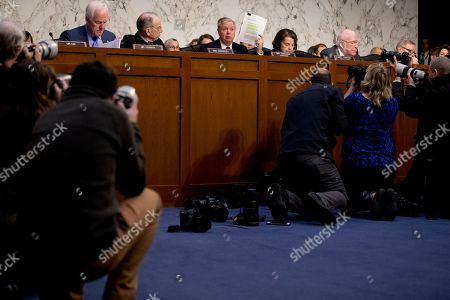 Chuck Grassley, Lindsey Graham, Dianne Feinstein, John Cornyn, Patrick Leahy. Chairman Lindsey Graham, R-S.C., center, accompanied by Sen. John Cornyn, R-Texas, left, Sen. Chuck Grassley, R-Iowa, second from left, and Ranking Member Sen. Dianne Feinstein, D-Calif., second from right, and Sen. Patrick Leahy, D-Vt., right, holds up a report while giving an opening statement as Department of Justice Inspector General Michael Horowitz, center foreground, testifies at a Senate Judiciary Committee hearing on the Inspector General's report on alleged abuses of the Foreign Intelligence Surveillance Act, on Capitol Hill in Washington