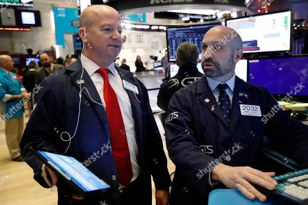 Patrick Casey, James Denaro. Trader Patrick Casey, left, and specialist James Denaro work on the floor of the New York Stock Exchange, . Stocks are opening mixed on Wall Street following news reports that US President Donald Trump might delay a tariff hike on Chinese goods set to go into effect this weekend