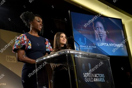 "Danai Gurira, America Ferrera. Danai Gurira, left, and America Ferrera announce Lupita Nyong'o as a nominee for outstanding performances by a female actor in a leading role for ""Us"" at the 26th annual Screen Actors Guild Awards nominations announcement at the Pacific Design Center, in West Hollywood, Calif. The show will be held on Sunday, Jan. 19, 2020, in Los Angeles"