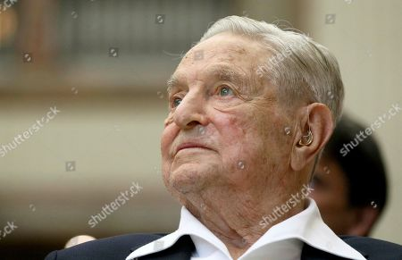 Stock Photo of George Soros, Founder and Chairman of the Open Society Foundations, looks before the Joseph A. Schumpeter award ceremony in Vienna, Austria. Soros is playing a key part in conservative efforts to defend President Donald Trump ahead of a looming impeachment vote. It's hardly a new role for Soros, whose multi-billion-dollar philanthropic network and investment in Democratic politics has made him a long-running enemy for the far right