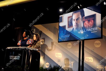 Danai Gurira (L) and US actress America Ferrera attend the nomination announcements for the 26th annual Screen Actors Guild Awards as US actor Bill Hader is shown on a screen at the Pacific Design Center in West Hollywood, California, USA, 11 December 2019. The 26th Annual SAG Awards ceremony will be held on 19 January 2020.