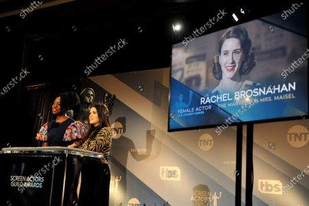 Danai Gurira (L) and US actress America Ferrera attend the nomination announcements for the 26th annual Screen Actors Guild Awards as US actress Rachel Brosnahan is shown on a screen at the Pacific Design Center in West Hollywood, California, USA, 11 December 2019. The 26th Annual SAG Awards ceremony will be held on 19 January 2020.