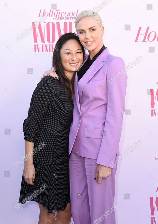 Beth Kono, Charlize Theron. Beth Kono, left, and Charlize Theron arrive at The Hollywood Reporter's Women in Entertainment Breakfast Gala, in Los Angeles