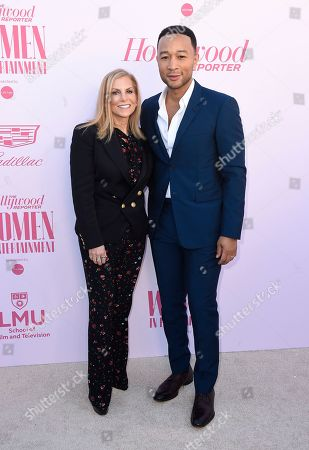 Stock Photo of Dawn Ostroff, John Legend. Dawn Ostroff, left, and John Legend arrive at The Hollywood Reporter's Women in Entertainment Breakfast Gala, in Los Angeles