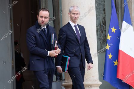 French Junior Minister for territorial communities Sebastien Lecornu (L) and French Culture Minister Franck Riester leave the Elysee palace after the meeting
