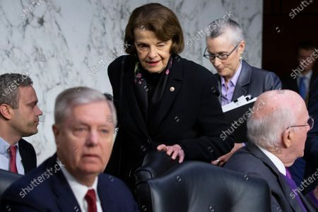 Democratic Senator from California Dianne Feinstein (C) arrives behind Republican Senator from South Carolina and Chairman of the Senate Judiciary Committee Lindsey Graham (L) to attend the Senate Judiciary Committee hearing examining the Inspector General's report on alleged abuses of the Foreign Intelligence Surveillance Act (FISA), on Capitol Hill in Washington, DC, USA, 11 December 2019. The report issued by the Justice Department's watchdog states that the launch of the original FBI investigation into the 2016 Trump presidential campaign had a solid legal basis, contradicting Trump's claim his campaign was victim of a 'witch hunt'.