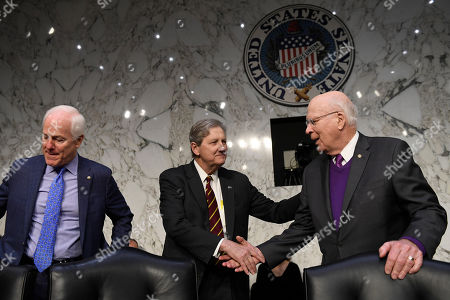 John Kennedy, Patrick Leahy, John Cornyn. Sen. John Kennedy, R-La., center, shakes hands with Sen. Patrick Leahy, D-Vt., right, as Sen. John Cornyn, R-Texas, left, sits down before the start of a Senate Judiciary Committee hearing on Capitol Hill in Washington, to look at the Inspector General's report on alleged abuses of the Foreign Intelligence Surveillance Act