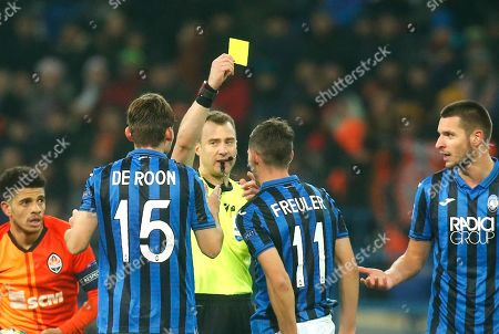 Stock Picture of A referee Felix Zwayer gives yellow card to Atalanta's Remo Freuler during the Group C Champions League soccer match between FC Shakhtar Donetsk and Atalanta in Kharkiv, Ukraine
