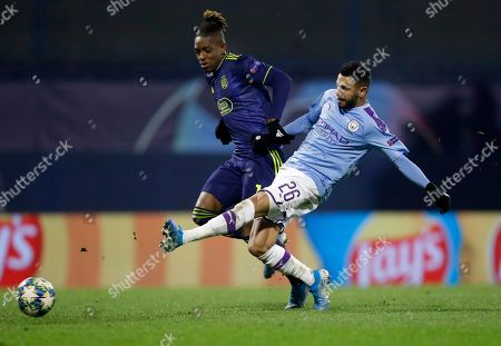 Manchester City's Riyad Mahrez, front, duels for the ball with Dinamo Zagreb's Francois Moubandje during the Champions League group C soccer match between Dinamo Zagreb and Manchester City at Maksimir Stadium in Zagreb, Croatia