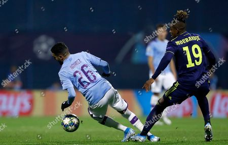 Manchester City's Riyad Mahrez, left, duels for the ball with Dinamo Zagreb's Francois Moubandje during the Champions League group C soccer match between Dinamo Zagreb and Manchester City at Maksimir Stadium in Zagreb, Croatia