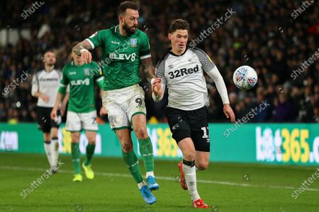 Derby County midfielder George Evans (17) & Sheffield Wednesday forward Steven Fletcher (9) chase the ball during the EFL Sky Bet Championship match between Derby County and Sheffield Wednesday at the Pride Park, Derby