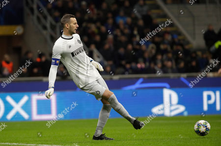 Inter Milan's goalkeeper Samir Handanovic controls the ball during the Champions League, group F soccer match between Inter Milan and F.C. Barcelona, at the San Siro stadium in Milan, Italy