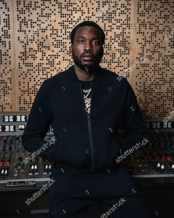 """This photo shows Meek Mill posing for a portrait at Jungle City Studios in New York. Mill, born Robert Rihmeek Williams, is competing for a Grammy Award for best rap album with the platinum-seller """"Championships,"""" his passionate project detailing his life"""