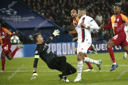 Paris Saint Germain's Kylian Mbappe (C) in action against Galatasaray's goalkeeper Fernando Muslera (L) during the UEFA Champions League Group A soccer match between Paris Saint Germain and Galatasaray at the Parc des Princes stadium in Paris, France, 11 December 2019.