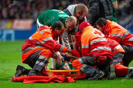 Red Cross members prepare Lokomotiv Moscow's player Vedran Corluka to leave the pitch during a UEFA Champions League group stage soccer match between Atletico Madrid and FC Lokomotiv Moscow at the Wanda Metropolitano stadium in Madrid, Spain, 11 December 2019.