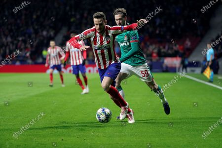 Atletico Madrid's Saul Niguez (L) in action against FC Lokomotiv Moscow's Aleksei Miranchuk (R) during the UEFA Champions League group stage soccer match between Atletico Madrid and FC Lokomotiv Moscow at the Wanda Metropolitano stadium in Madrid, Spain, 11 December 2019.
