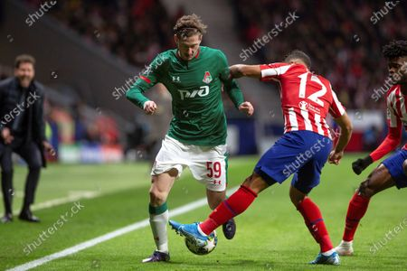 Atletico Madrid's Renan Lodi (R) in action against FC Lokomotiv Moscow's Aleksei Miranchuk (L) during the UEFA Champions League group stage soccer match between Atletico Madrid and FC Lokomotiv Moscow at the Wanda Metropolitano stadium in Madrid, Spain, 11 December 2019.