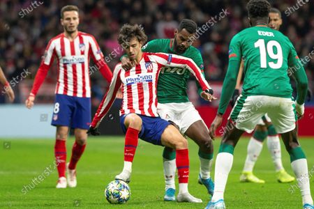 Stock Photo of Atletico Madrid's Joao Felix (L) in action against FC Lokomotiv Moscow's Brian Idowu (R) during the UEFA Champions League group stage soccer match between Atletico Madrid and FC Lokomotiv Moscow at the Wanda Metropolitano stadium in Madrid, Spain, 11 December 2019.
