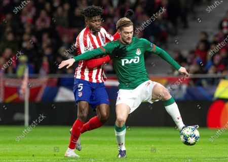 Atletico Madrid's Thomas Partey (L) in action against FC Lokomotiv Moscow's Aleksei Miranchuk (R) during the UEFA Champions League group stage soccer match between Atletico Madrid and FC Lokomotiv Moscow at the Wanda Metropolitano stadium in Madrid, Spain, 11 December 2019.