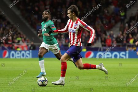 Atletico Madrid's Joao Felix (R) in action against FC Lokomotiv Moscow's Brian Idowu (L) during the UEFA Champions League group stage soccer match between Atletico Madrid and FC Lokomotiv Moscow at the Wanda Metropolitano stadium in Madrid, Spain, 11 December 2019.