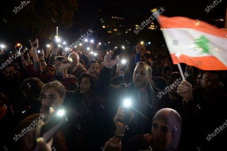 Anti-government protesters shout slogans during a protest against the Lebanese Parliament Speaker Nabih Berri after his security's attack on protestors in Verdun neighborhood on 10 December in front of the Lebanese Interior Ministry in Beirut, Lebanon, 11 December 2019. Protesters aim to apply pressure on the country's political leaders to over what they view as a lack of progress following the Prime Minister's resignation on 29 October, demand to speed up the process to the appointment of a new Prime Minister, without the corrupt political class. Lebanese President Michel Aoun called for formal consultations on 09 December with lawmakers to designate a new Prime Minister, but it was canceled after the candidate Samir Khatib announced his withdrawal from the candidacy, after his visit Dar Al Fatwa, as said to media that, the country's top Sunni religious authority told him the community supports resigned Prime Minister Saad Hariri to take back the post.