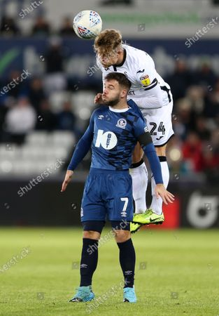Stock Image of Jake Bidwell of Swansea City gets above Adam Armstrong of Blackburn Rovers.