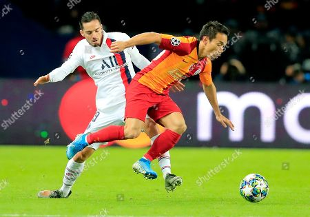 PSG's Pablo Sarabia, left, challenges for the ball with Galatasaray's Yuto Nagatomo during the Champions League, group A soccer match between PSG and Galatasaray, at the Parc des Princes stadium in Paris