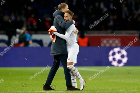 PSG's head coach Thomas Tuchel embraces PSG's Neymar at the end of the Champions League group A soccer match between PSG and Galatasaray at the Parc des Princes stadium in Paris, . PSG won 5-0