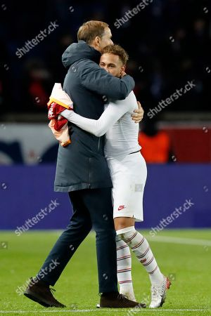 Stock Image of PSG's head coach Thomas Tuchel embraces PSG's Neymar at the end of the Champions League group A soccer match between PSG and Galatasaray at the Parc des Princes stadium in Paris, . PSG won 5-0