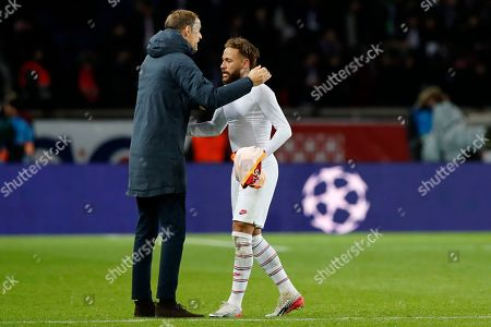 Stock Picture of PSG's head coach Thomas Tuchel embraces PSG's Neymar at the end of the Champions League group A soccer match between PSG and Galatasaray at the Parc des Princes stadium in Paris, . PSG won 5-0