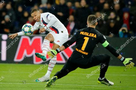 Stock Image of PSG's Kylian Mbappe takes a shot in front of Galatasaray's goalkeeper Fernando Muslera during the Champions League group A soccer match between PSG and Galatasaray at the Parc des Princes stadium in Paris