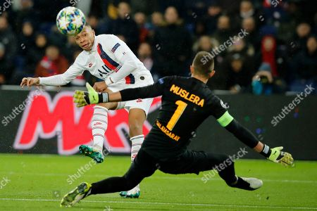 PSG's Kylian Mbappe takes a shot in front of Galatasaray's goalkeeper Fernando Muslera during the Champions League group A soccer match between PSG and Galatasaray at the Parc des Princes stadium in Paris