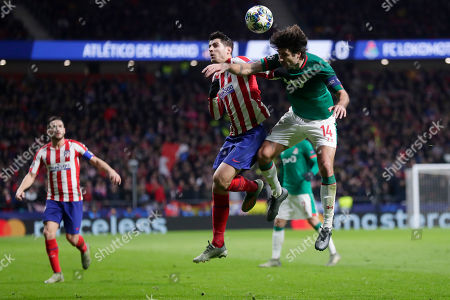 Lokomotiv's Vedran Corluka, right, vies for the ball with Atletico Madrid's Alvaro Morata during the Champions League Group D soccer match between Atletico Madrid and Lokomotiv Moscow at Wanda Metropolitano stadium in Madrid, Spain