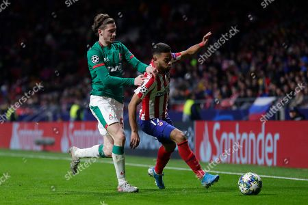 Lokomotiv's Aleksei Miranchuk for the ball with Atletico Madrid's Renan Lodi during the Champions League Group D soccer match between Atletico Madrid and Lokomotiv Moscow at Wanda Metropolitano stadium in Madrid, Spain