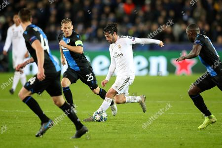 Real Madrid's Isco, center, is pursued by Brugge's Ruud Vormer, second left, during the Champions League group A soccer match between Brugge and Real Madrid at the Jan Breydel stadium in Bruges, Belgium