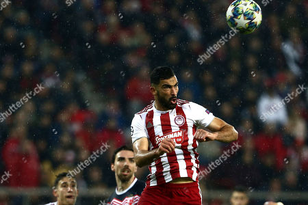 Olympiakos' Yassine Meriah jumps for the ball during the Champions League group B soccer match between Olympiakos and Red Star at the Georgios Karaiskakis stadium in Piraeus port, near Athens