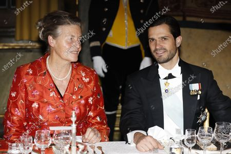 Francoise Helen Mayor and Prince Carl Philip at the traditional dinner for the Nobel laureates at the Royal Palace